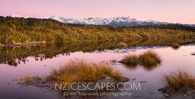 Twilight reflections of Southern Alps in coastal lagoon near Okarito, Westland Tai Poutini National Park, West Coast, UNESCO Wolrd Heritage Area, New Zealand, NZ