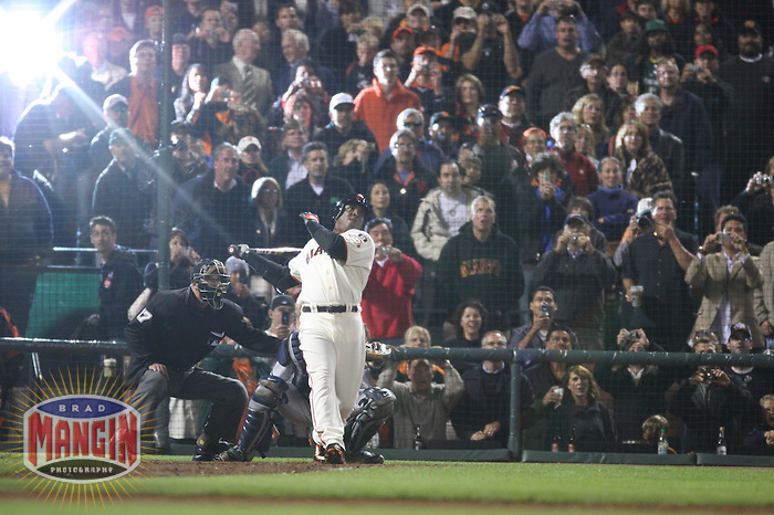 SAN FRANCISCO - AUGUST 7:  Barry Bonds of the San Francisco Giants hits career home run #756 passing Hank Aaron on the all-time career list during the game against the Washington Nationals at AT&T Park in San Francisco, California on August 7, 2007.  Photo by Brad Mangin