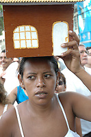 Círio de Nazaré 2005 <br /> <br /> Roman Catholic pilgrims press together while following the image of the local saint Our Lady of Nazareth as it is paraded during the annual Cirio de Nazare procession, the country's biggest religious festival, in the city of Belem, at the mouth of the Amazon River . More than one million Catholics, many of them from communities along the Amazon River's tributaries, converged on Our Lady of Nazareth basilica to participate in the event. <br /> <br /> Foto Lucivaldo Sena