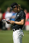 6 September 2008:    Camilo Villegas looks over information on the Bellerive Golf Course as he waits to putt on the first hole in the second round of play at the BMW Golf Championship at Bellerive Country Club in Town & Country, Missouri, a suburb of St. Louis, Missouri.  The BMW Championship is the third event on the PGA's Fed Ex Tour. Camillo Villegas, of Medellin Colombia (South America) was the leader after the conclusion of round one with a five-under par score.