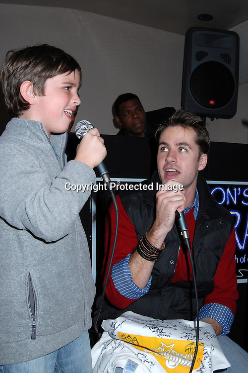 Miles Williams, John Driscoll singing..at The Gus Bus Harbor Cruise on October 15, 2006 on World Yacht Boat Temptress.                                         Robin Platzer, Twin Images