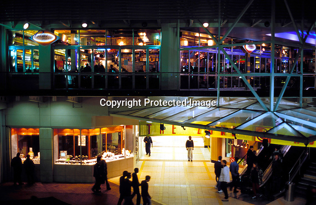 dibusho00102. Business. Shopping. JOHANNESBURG, SOUTH AFRICA - MAY 29: The Zone at Rosebank on May 29, 2002 a trendy shopping mall and gathering point for youth in Rosebank a suburb in Johannesburg, South Africa. Young people come here to hang out with other youth, black and white, and to check out the latest fashion clubs etc. After eight years into democracy a new black middleclass and elite is growing, and they have money to spend on houses, cars and entertainment. .Photo: Per-Anders Pettersson/iAfrika Photos....