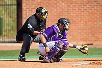 High Point Panthers catcher Josh Spano (21) catches a pitch as home plate umpire Ben Sass looks on during the game against the Coastal Carolina Chanticleers at Willard Stadium on March 15, 2014 in High Point, North Carolina.  The Chanticleers defeated the Panthers 1-0 in the first game of a double-header.  (Brian Westerholt/Four Seam Images)