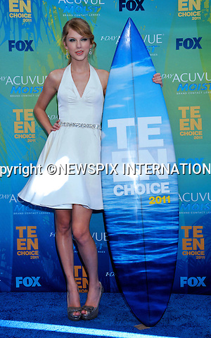 """TAYLOR SWIFT.attends the Teen Choice 2011 at the Gibson Amphitheatre, Universal City, California_07/08/2011.Mandatory Photo Credit: ©Crosby/Newspix International. .**ALL FEES PAYABLE TO: """"NEWSPIX INTERNATIONAL""""**..PHOTO CREDIT MANDATORY!!: NEWSPIX INTERNATIONAL(Failure to credit will incur a surcharge of 100% of reproduction fees).IMMEDIATE CONFIRMATION OF USAGE REQUIRED:.Newspix International, 31 Chinnery Hill, Bishop's Stortford, ENGLAND CM23 3PS.Tel:+441279 324672  ; Fax: +441279656877.Mobile:  0777568 1153.e-mail: info@newspixinternational.co.uk"""