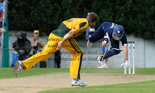 Scotland V Australia ODI at Grange CC, Edinburgh - Scotland capt Gavin Hamilton takes an acrobatic tumble, down but not out, off the bowling of Australian bowler Dirk Nannes - Picture by Donald MacLeod 28.08.09