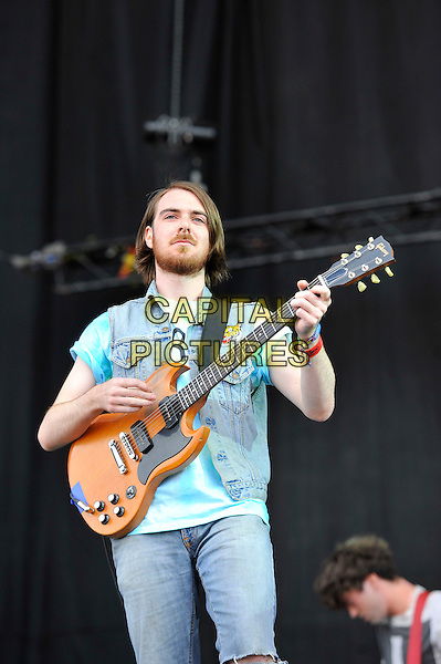 Tom Hudson of Pulled Apart By Horses.performing on Day 3 at Reading Festival, Reading, England. .26th August 2012.on stage in concert live gig performance performing music half length sleeveless jean denim jacket blue top beard facial hair guitar .CAP/MAR.© Martin Harris/Capital Pictures.