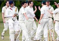 Tom Wakeford (C) of North London celebrates after dismissing J Fleming (L) during the Middlesex County Cricket League Division 2 game between North London and Hornsey at Park Road, Crouch End on Sat May 15, 2010