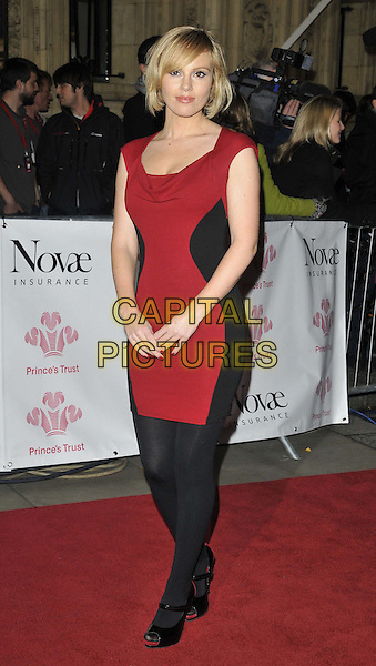 Michelle Dewberry.The Prince's Trust Rock Gala 2011, Royal Albert Hall, Kensington Gore, London, England..November 23rd, 2011.full length black dress red tights.CAP/CAN.©Can Nguyen/Capital Pictures.