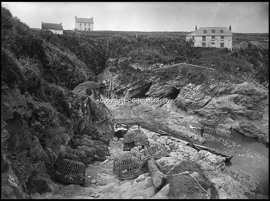 BNPS.co.uk (01202 558833)<br /> Pic: GibsonOfScilly/BNPS<br /> <br /> Remote Cornish 'smugglers house' in Bessier cove.<br /> <br /> An archive of eye-opening photographs documenting the grim reality of Poldark's Cornwall has emerged for sale for £25,000.<br /> <br /> More than 1,500 black and white images show the gritty lives lived by poverty-stricken families in late 19th and early 20th century Cornwall - around the same time that Winston Graham's famous Poldark novels were set.<br /> <br /> The collection reveals the lowly beginnings of towns like Rock, Fowey, Newquay and St Ives long before they became picture-postcard tourist hotspots.<br /> <br /> Images show young filth-covered children playing barefoot in squalid streets, impoverished families standing around outside the local tax office, and weather-beaten fishwives tending to the day's catch.<br /> <br /> The Cornish archive, comprising 1,200 original photographic prints and 300 glass negative plates, is tipped to fetch £25,000 when it goes under the hammer as one lot at Penzance Auction House.
