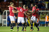 teammates celebrate with goal scorer Tosin Kehinde (centre) of Manchester United during the U23 Premier League 2 match between Chelsea and Manchester United at the EBB Stadium, Aldershot, England on 18 September 2017. Photo by Andy Rowland.