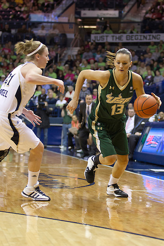 South Florida guard Inga Orekhova (#13) drives to the basket as Notre Dame guard Natalie Novosel (#21) defends in first half action of NCAA Women's basketball game between South Florida and Notre Dame.  The Notre Dame Fighting Irish defeated the South Florida Bulls 80-68 in game at Purcell Pavilion at the Joyce Center in South Bend, Indiana.