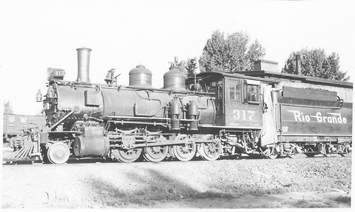 Fireman's-side view of D&amp;RGW #317 at Montrose.<br /> D&amp;RGW  Montrose, CO  Taken by Maxwell, John W. - 5/30/1948