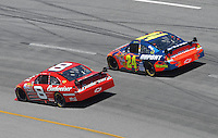 May 6, 2007; Richmond, VA, USA; Nascar Nextel Cup Series driver Jeff Gordon (24) races alongside Dale Earnhardt Jr (8) during the Jim Stewart 400 at Richmond International Raceway. The race is being run on Sunday after being rained out on Saturday evening. Mandatory Credit: Mark J. Rebilas
