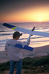 Gary Legerton prepares to launch glider+at sunset, Carlsbad Beach, Carlsbad, San Diego County, CALIFORNIA