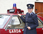 23/7/2015.    Graduating from the Garda College in Templemore this Thursday was Aishling O'Sullivan from Waterville, Co. Kerry who has her eye on this 1977 Vauxhall Victor patrol car.  Garda O'Sullivan will be stationed in Roxboro, Limerick.<br /> Photograph Liam Burke/Press 22