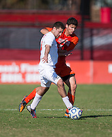 David Fiorello (7) of Virginia Tech fights for the ball with Nazmi Albadawi (10) of North Carolina State during the game at Ludwig Field in College Park, MD. Virginia Tech defeated North Carolina State, 3-2, in the ACC tournament play-in game.