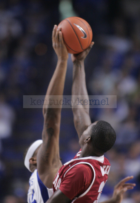 Freshman forward DeMarcus Cousins and Alabama's sophomore forward Jamychal Green tip-off the ball during the UK men's basketball game against Alabama at Rupp Arena on Tuesday, Feb. 9, 2010. Photo by Adam Wolffbrandt | Staff