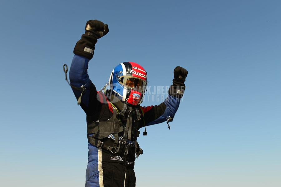 Sept. 23, 2012; Ennis, TX, USA: NHRA funny car driver Bob Tasca III celebrates after winning the Fall Nationals at the Texas Motorplex. Mandatory Credit: Mark J. Rebilas-US PRESSWIRE