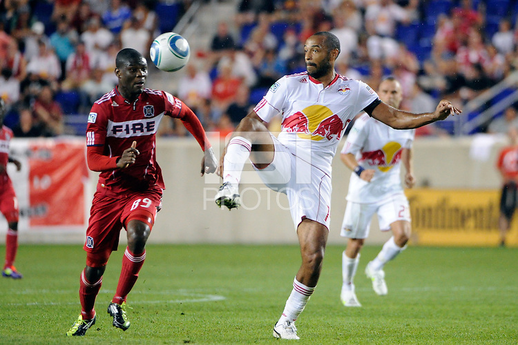 Thierry Henry (14) of the New York Red Bulls plays the ball under pressure from Yamith Cuesta (89) of the Chicago Fire. The New York Red Bulls and the Chicago Fire played to a 2-2 tie during a Major League Soccer (MLS) match at Red Bull Arena in Harrison, NJ, on August 13, 2011.