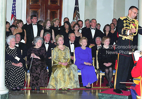"""The President's House: A Bicentennial Tribute"" composed by John Tatgenhorst is performed for the first time by the United States Marine Band at the 200th Anniversary of the White House Dinner in Washington, D.C. on November 9, 2000.  Watching the performance from left to right in the front row are: Former first lady Barbara Bush, former first lady Lady Bird Johnson, first lady Hillary Rodham Clinton, former first lady Betty Ford, and former first lady Rosalynn Carter.  Seated behind the first ladys are, from left to right: former U.S. President George H.W. Bush, U.S. President Bill Clinton, former U.S. President Gerald R. Ford, and former U.S. President Jimmy Carter.  Chelsea Clinton is standing behind President Clinton.<br /> Credit: Ron Sachs / CNP"