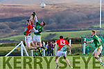 Mathew O'Sullivan for St Michaels/Foilmore and Skellig Rangers Stephen O'Sullivan battle it out in the air.