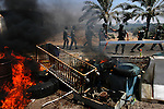 "Over a burning barricade, Israeli policemen charge the entrance of ""Palm Beach"" hotel in order to evacuate settlers, in the Israeli settlement bloc of Gush Katif, Gaza Strip. Hardliners from the West Bank have taken-over the hotel, setting it as their base for future struggle against Israel's upcoming pullout from Gaza. They renamed it to ""Ma'oz Hayam"" outpost."