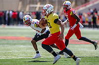 College Park, MD - April 27, 2019: Maryland Terrapins quarterback Tyler DeSue (13) runs the ball during the spring game at  Capital One Field at Maryland Stadium in College Park, MD.  (Photo by Elliott Brown/Media Images International)