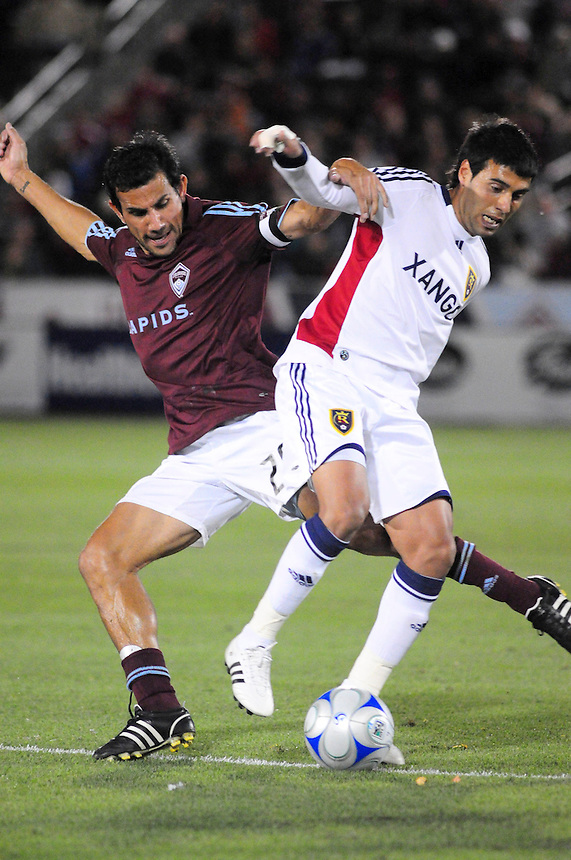 25 October 08: Rapids midfielder PabloMastroeni (in red) against Real Salt Lake midfielder Javier Morales (11). Real Salt Lake tied the Colorado Rapids 1-1 at Dick's Sporting Goods Park in Commerce City, Colorado. The tie advanced Real Salt Lake to the playoffs.