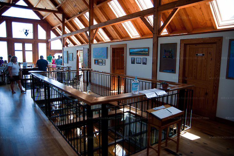 Many windows admit lots of light and bring the outdoors into the spacious, rustic-styled tasting room at Blenheim Vineyards.