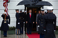 United States President Donald J. Trump, center left, and First lady Melania Trump, center right, await the arrival of the Prime Minister of Greece Kyriakos Mitsotakis and his wife Mareva Grabowski outside of the White House in Washington, D.C., U.S., on Tuesday, January 7, 2020.<br /> <br /> Credit: Stefani Reynolds / CNP/AdMedia