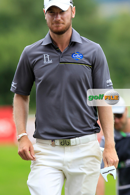 Chris Wood (ENG) walks to the 14th tee during Sunday's Final Round of the 2014 Irish Open held at Fota Island Resort, Cork, Ireland. 22nd June 2014.<br /> Picture: Eoin Clarke www.golffile.ie