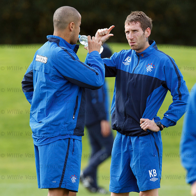 Kirk Broadfoot with a small problem as he chats to Madjid Bougherra
