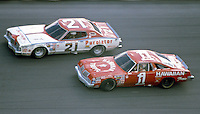 Neil Bonnett ,#21 Mercury, races beside Donnie Allison, #1 Oldsmobile, in the Daytona 500, Daytona International Speedway, Daytona Beach, FL, February 17, 1980.  (Photo by Brian Cleary/www.bcpix.com)
