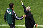 05 July 2006: Head coach Raymond Domenech (FRA) expresses displeasure as the official asks him to return to the bench area. France defeated Portugal 1-0 at the Allianz Arena in Munich, Germany in match 62, the second semifinal game, in the 2006 FIFA World Cup.