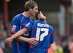 Aldershot Town's David Winfield congratulates teammate Kirk Hudson on scoring their team's second goal during the League 2 fixture between Crewe Alexandra and Aldershot Town at the Alexandra Stadium. The visitors won by 2 goals to 1.