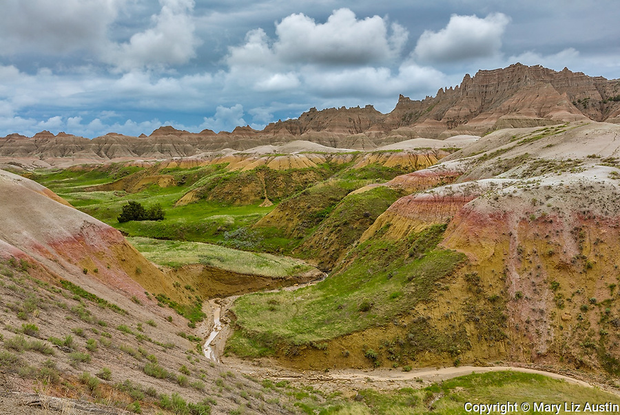 Badlands National Park, South Dakota: Clearing storm clouds over the eroded Yellow Mounds landforms near Dillon pass