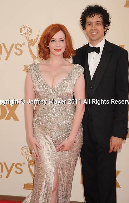 LOS ANGELES, CA - SEPTEMBER 18: Christina Hendricks and Geoffrey Arend arrive at the 63rd Primetime Emmy Awards at the Nokia Theatre L.A. Live on September 18, 2011 in Los Angeles, California.