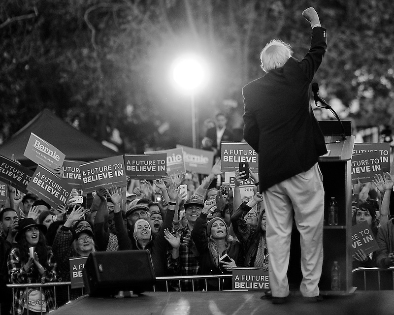 Sen. Bernie Sanders pumps his fist in front of thousands of supporters after delivering his stump speech outside of Colton Hall in Monterey, California on May 31, 2016.