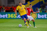 Sweden's Zlatan Ibrahimovic (L) and Hungary's Zsolt Korcsmar (R) fight for the ball during the UEFA EURO 2012 Group E qualifier Hungary playing against Sweden in Budapest, Hungary on September 02, 2011. ATTILA VOLGYI