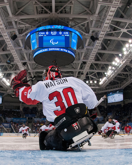 Sochi, RUSSIA - Mar 11 2014 -  Corbin Watson makes a glove save as Canada takes on Czech Republic in Sledge Hockey at the 2014 Paralympic Winter Games in Sochi, Russia.  (Photo: Matthew Murnaghan/Canadian Paralympic Committee)