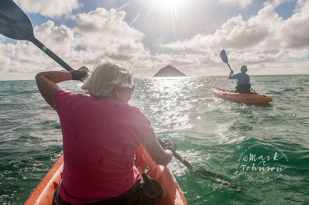 2 mature women kayaking near the Mokulua Islands, Kailua Bay