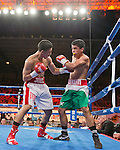 Joel Diaz Jr, from Palm Dale, CA, left, fights Kevin Aguilar from San Luis Potosi, Mexico in the Super Featherwright bout during the Rural Rumble on Friday night, August 8, 2014 at Churchill County Fairgrounds in Fallon, Nevada.
