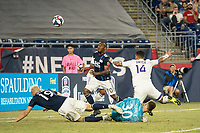 FOXBOROUGH, MA - JULY 27:  Dom Dwyer #14 collides with Matt Turner #30 attempting a shot on goal at Gillette Stadium on July 27, 2019 in Foxborough, Massachusetts.