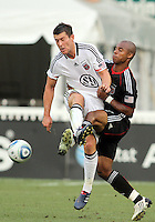 Julius James #2 of D.C. United knocks the ball away from David Nugent #24 of Portsmouth FC during an international friendly match at RFK Stadium on July 24 2010, in Washington D.C. United won 4-0.