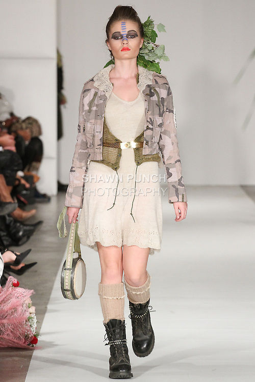 Model walks runway in an outfit from the Repurposed/Reused Spring Summer 2015 Urban Warrior collection, during Fashion Week Brooklyn Spring Summer 2015.