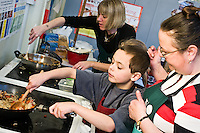 Margaret Mountford, an LSA at Ludlow Junior School in Southampton and Lindsay Bowers, organised for nearly all of school's 640 ish children to mix together the ingredients of a Chow Mein noodle stir fry and cook them on just three stoves as part of Let's Get Cooking's Big Cookathon.  They had the help of teachers, teaching assistants and a few parents.???UNP 24985/Kindred (London)??Lets Get Cooking, Big Cookathon, Southampton??Let's Get Cooking is organising the second annual 'BIG Cookathon' on Tuesday 16 March, 2010. It will be a national event in which as many clubs as possible across the country will participate in a community cooking activity.??Contact in advance of the day.Ed Callow - Kindred (PR agency).0207 612 8860.07732 088 33???Date Taken: 16/03/10??Location:?Ludlow Junior School, Peveril Road, Southampton, SO19 2DW??Contact:?Lindsay Bowers.07800 565774??Commissioned by:  UNP?Mandy Taylor?UNP Ltd.24 Victoria Road,.Saltaire,.BD18 3JR.England, UK.P 01274 412222.F 01274 590999.iSDN 01274 420446.email: mandy@unp.co.uk