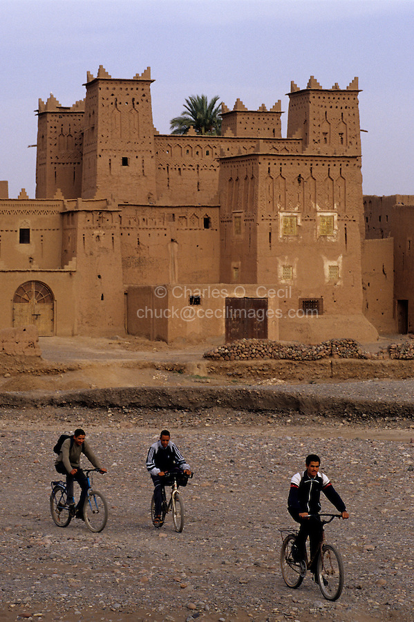Near Skoura, Morocco - Boys Biking, Kasbah Ameridhil in Background.