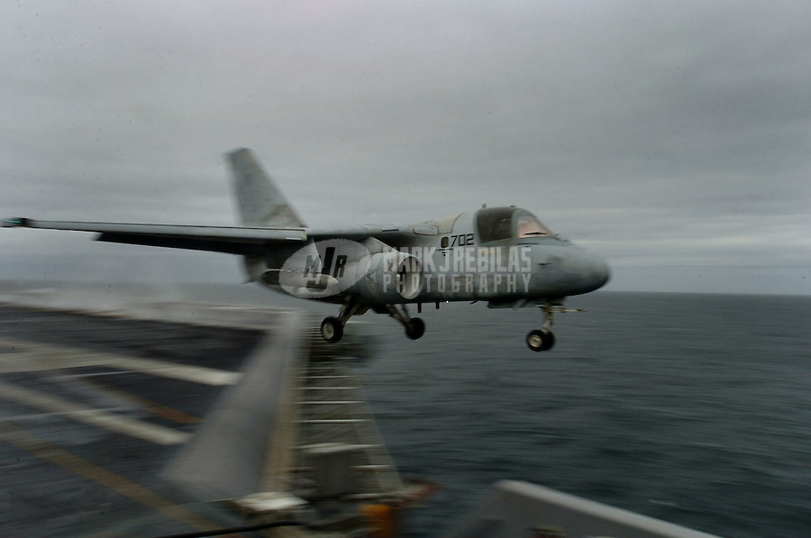 """040605-N-6213R-003 Gulf of Alaska (June 5, 2004) - An S-3B Viking from the """"Blue Wolves"""" of Sea Control Squadron Three Five (VS-35) launches from the flight deck aboard USS John C. Stennis (CVN 74). The S-3B Viking, an anti-submarine detection aircraft used extensively during the Cold War, is slowly being phased out of military service.   Stennis and embarked Carrier Air Wing Fourteen (CVW-14) are currently at sea participating in Exercise Northern Edge while on a scheduled deployment.  Photo by Mark J. Rebilas"""