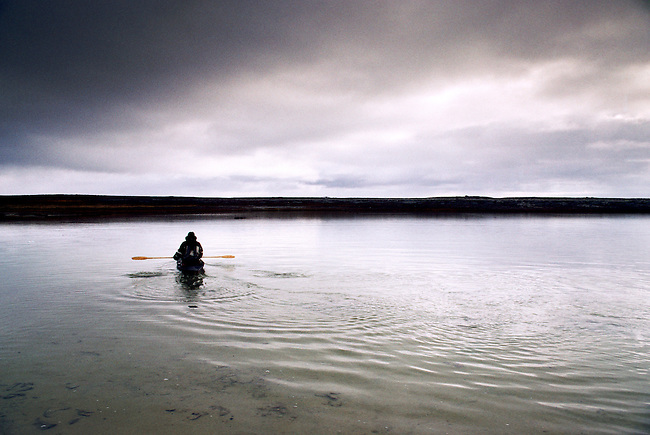 CANADA, NWT, HUDSON BAY, SOUTH  HAMPTON ISLAND, NATIVE PT, INUIT IN TRADITIONAL KAYAK