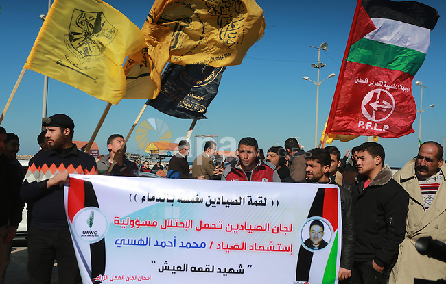 Palestinians take part in a protest to know the fate of a Palestinian fisherman Muhammad Al-Hissi who went missing Wednesday after an encounter with Israeli forces, was announced dead on Friday, in Gaza city, on January 7, 2017. Gazan fishermen, whose numbers are estimated to be around 4,000, have suffered from a near decade-long siege of the Gaza Strip, which limits fishermen to just six nautical miles into the sea in accordance with the ceasefire agreement signed with Palestinian factions in 2014. Photo by Mohammed Asad